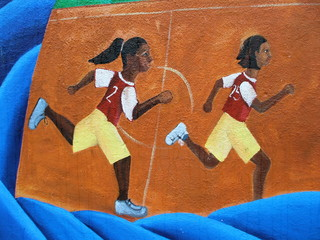 Neighborhood Mural of Female Children Playing Basketball
