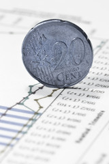 euro twenty cent coin on financial data papers