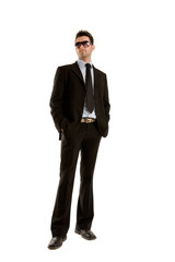 Young businessman whole figure with stylish sunglasses.