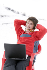 Happy teens student with laptop in hand in winter mountains
