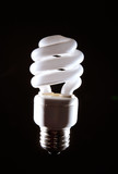 Cfl fluorescent lightbulb on dark background