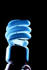 blue hue of cfl lightbulb on black