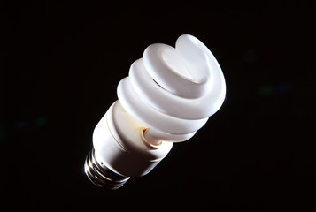 Cfl fluorescent lightbulb on dark background