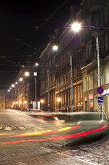 City street in the night with blurred cars and traffic lights