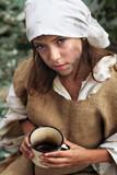 Poor little beggar girl with a vintage mug in her hand poster
