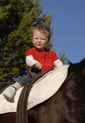 riding little boy