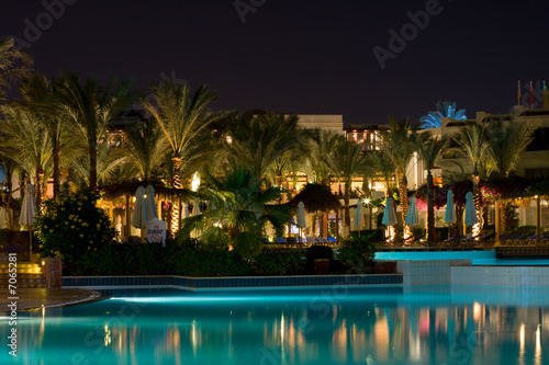 Plexiglas Egypte Night swimming pool side of tropical hotel