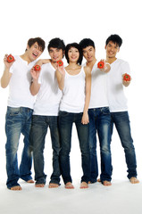 Five Asian young men holding Tomatoes on their hands