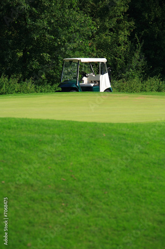 Golf car on the green - 7068475