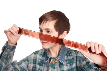The teenager examines the staff on a photofilm