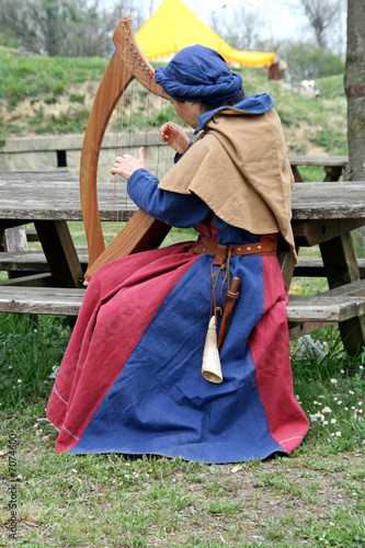 a celtic harp player during a medieval fair in Italy