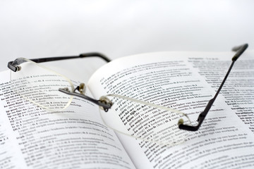 Dutch dictionary and glasses. Shallow DOF. Focus on Islam