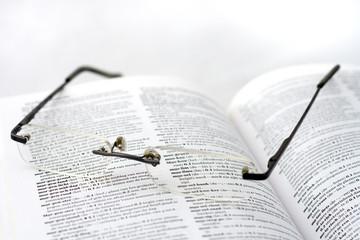 Dutch dictionary and glassses. shallow DOF. focus on Islam