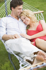 Young couple relaxing in hammock