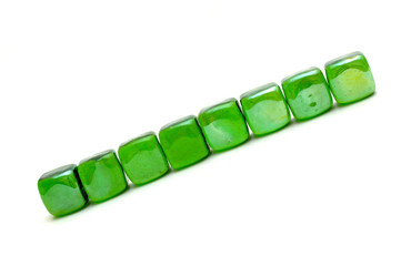 the row of green stones isolated over white