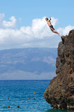 Middle age male Jumping off Black Rock in Maui Hawaii