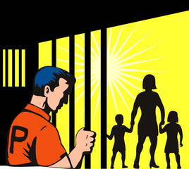 Prisoner behind bars with family outside