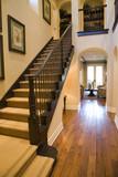 Luxury home hallway with a hardwood floor. poster