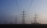 transmission facilities at daybreak poster