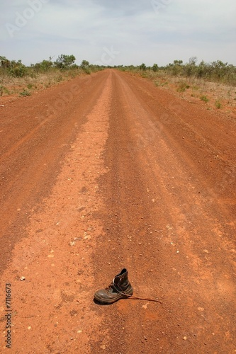 Shoe on the middle of road