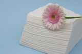 pink gerber daisy and napkin papers poster