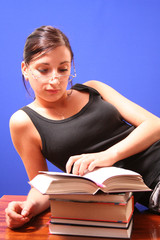 The girl reads the book