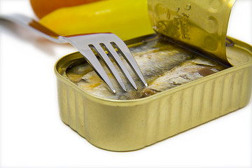 open can of sardines with fork
