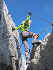 woman climbing on ferrata 2