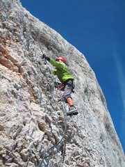 woman climbing on ferrata