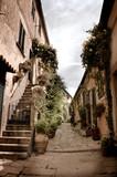 Old alley in Marciana, small village of Elba island-