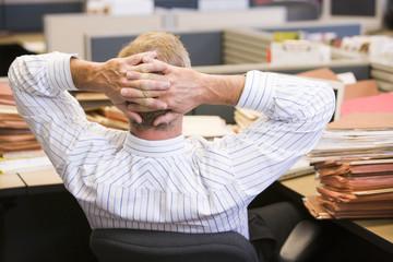 Businessman relaxing at desk