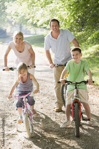 Poster Family on bicycle ride