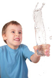 boy spills water from glass