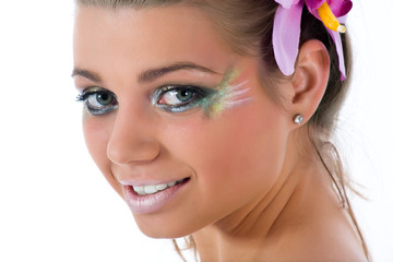 Girl with face-art butterfly paint