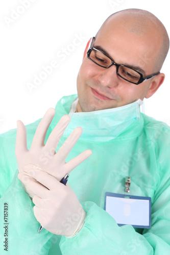 surgeon putting medical gloves on
