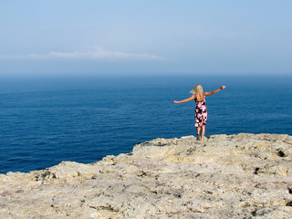 female on continenatal europe's most western cliff in portugal