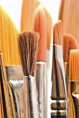 Various sized paintbrushes with shallow depth of field