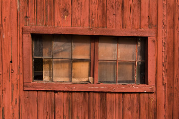 Rustic window in a red barn