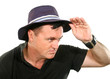 Man Looks Away In Hat
