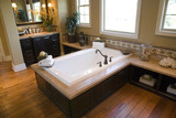 Fototapety Designer bathroom with a modern tub and hardwood floor.