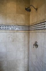 Luxurious tiled shower in a modern bathroom.