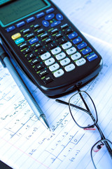 Scientific Calculator with exercise books and glasses