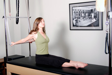 Pilates Instructor Working on Cadillac