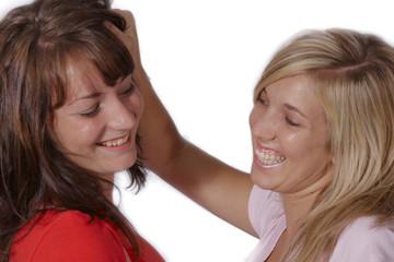 Playful girls pulling hair