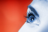 Blue eye on red background (shallow DoF) poster