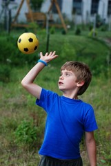 Young goalkeeper with the ball