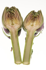 artichoke sliced in half on white background