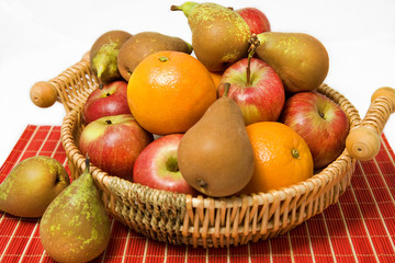 Basket of ripe fruit isolated on white background