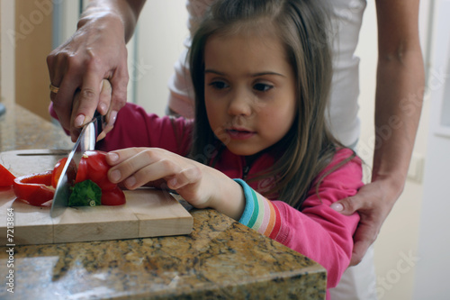 girl learning to cook