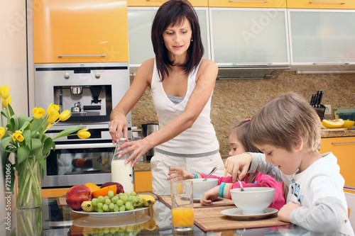 Beautiful mother serving breakfast